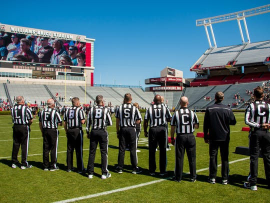 The officiating crew during the playing of the national