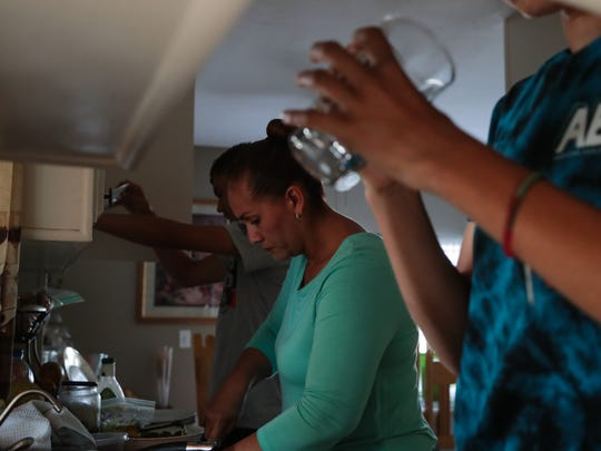 Arcelia Duarte cooks dinner at her home in Thermal,