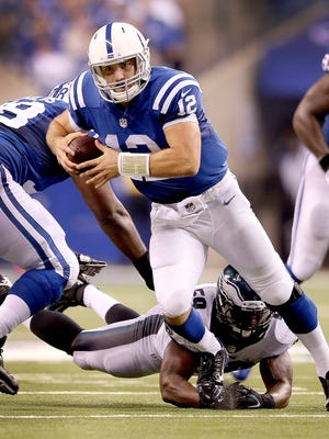 Indianapolis Colts Andrew Luck is shoe-stringed tackled by Philadelphia Eagles DeMeco Ryans in the third quarter. The Indianapolis Colts play the Philadelphia Eagles Monday, September 15, 2014, evening at Lucas Oil Stadium.