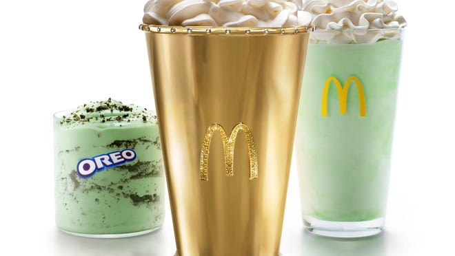 Six days after the nationwide return of the popular, mint-flavored shake, McDonald's announced Tuesday it is auctioning off a jewel-and-diamond-encrusted 18-karat gold cup, called the Golden Shamrock Shake, with bids starting at $1.