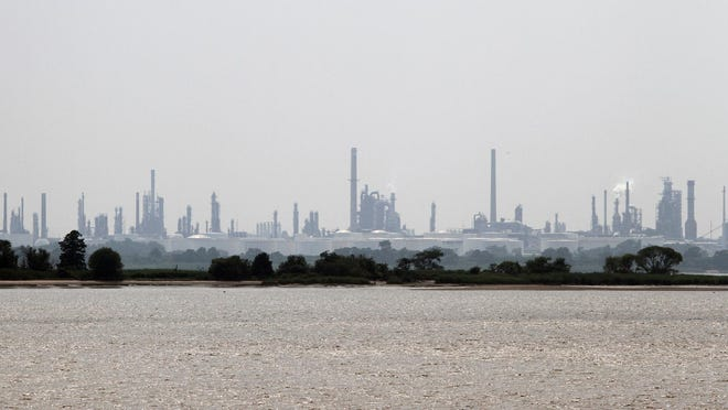 The Delaware City Refinery is seen rising beyond the north end of Pea Patch Island from Ft. Mott in New Jersey.