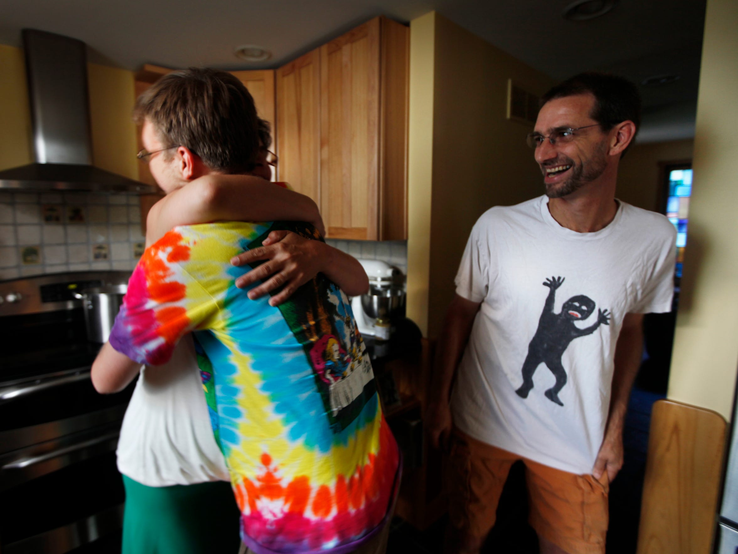 Laurie hugs Joe's son Aaron after arriving from San