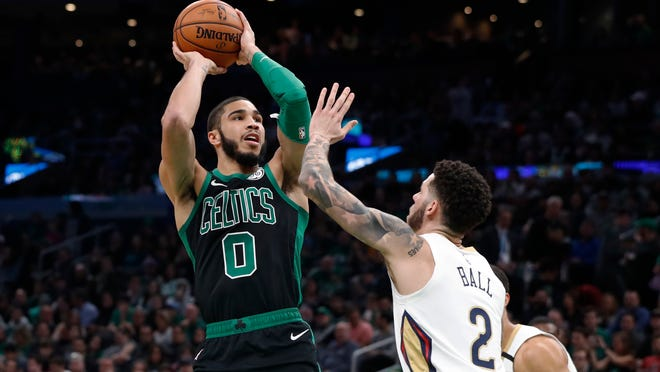 Boston Celtics' Jayson Tatum shoots over New Orleans Pelicans' Lonzo Ball during the first quarter of an NBA basketball game Saturday, Jan. 11, 2020, in Boston.