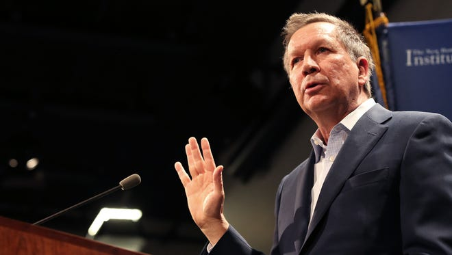 "As John Kasich's allies assemble a national team, they've hired a GOP strategist who helps lead a pro-gay-marriage group. Here, Kasich addresses a crowd at ""Politics & Eggs"" in Manchester, N.H., on Tuesday, March 24, 2015."