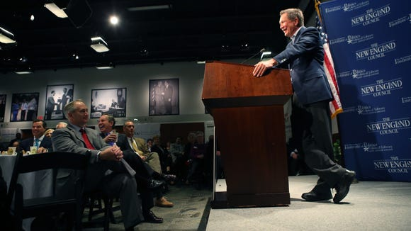 Gov. John Kasich addresses a crowd at a New Hampshire