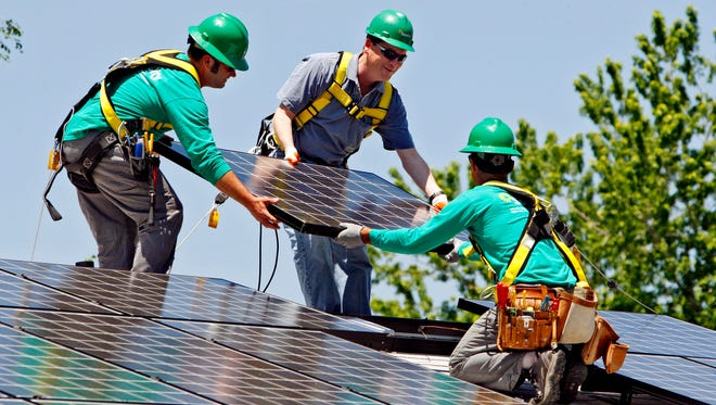 SolarCity installs panels in Denver in 2010. Now, it is reaching out to rivals for potential partnerships.