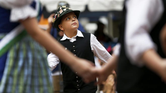 James Fightmaster dances with Donauschwaben middle group at Oktoberfest Zinzinnati on Fountain Square Saturday, Sept.19, 2015. It is the largest Oktoberfest celebration in the country.