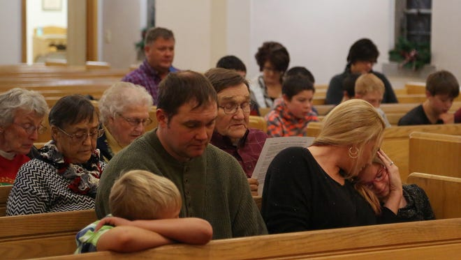 Amy Madsen comforts her daughter Ashlyn, of Audubon, during a prayer service at Our Saviour's Lutheran Church, lead by Pastor Doug Opp, on Sunday, Dec. 11, 2016, in Audubon. The weekly service focused today on the death of two boys in the community, Jameson, 14 and Gavin, 11, Steckler. The Stecklers were killed in a car accident Saturday that also inured their mother.
