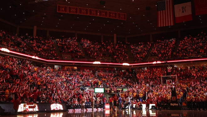 Fans hold red glow sticks before the Iowa State men's basketball game against No. 1 ranked Kansas, 76-72, on Monday, Jan. 16, 2017, in Hilton Coliseum. The Cyclones lost 76-72.