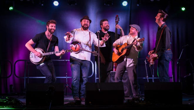 "The Hillbenders — from left, Mark Cassidy on banjo, Nolan Lawrence on mandolin, Gary Rea on bass, Jim Rea on guitar and Chad Graves on dobro — will perform ""Tommy: A Bluegrass Opry"" at the Deane Center in Wellsboro."