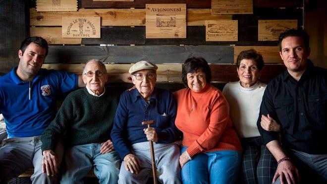 Matthew Frommeyer, Joe Bonavita, Lou Bonavita, Anna Bonavita, Gail Vilardo Frommeyer and Joseph Frommeyer Jr. pose for a portrait at Buona Vita Pizzeria in Crescent Springs, Ky. Wednesday, February 15, 2017.