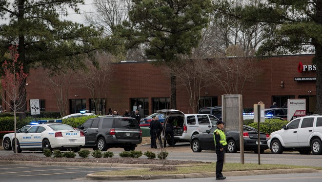 Memphis police investigate the scene of a shooting at Plasma Biological Services where one person was pronounced dead at the scene Friday, March 17, 2017.