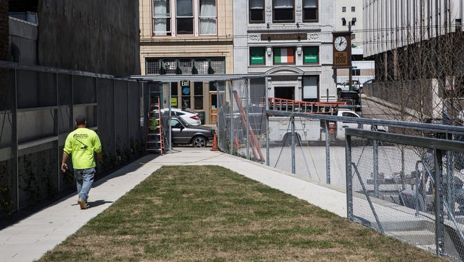 March 28, 2017 - A worker walks towards  Madison Avenue while putting the finishing touches on the new pocket park at 151 Madison.