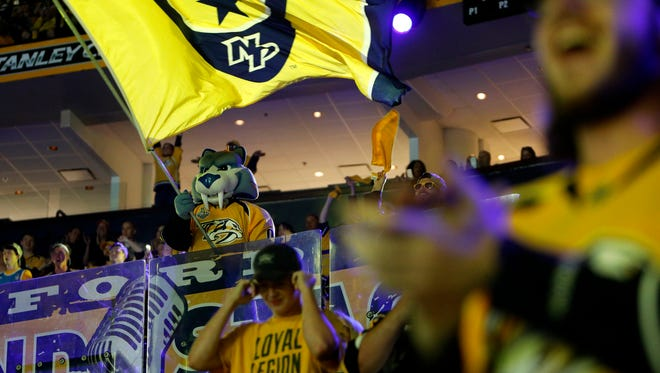 Fans cheer on the Predators from inside Bridgestone Arena during game five of the Stanley Cup Thursday, June 8, 2017.