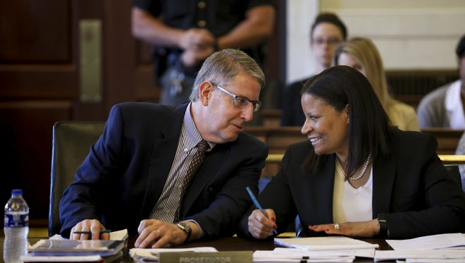 Hamilton County assistant prosecutors Seth Tieger and Stacey DeGraffenreid talk during the sixth day of Raymond Tensing's retrial in Hamilton County Common Pleas Judge Leslie Ghiz's courtroom Thursday, June 15, 2017.