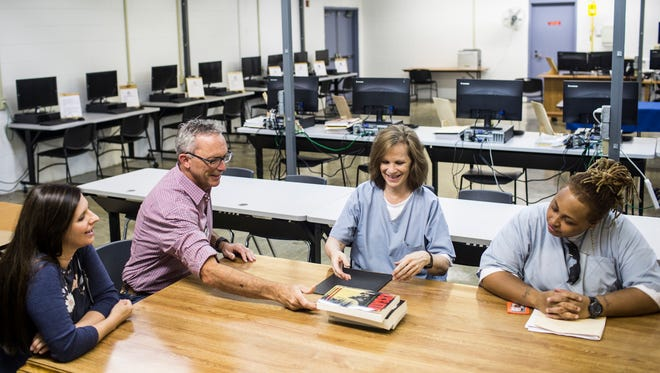 July 7, 2017 - Dr. Steve Haynes, second from left, spreads out books before a discussion with Denice Smith, second from right, and Brandyce Lusby, right, at the WomenÕs Therapeutic Residential Center (WTRC) at the West Tennessee State Penitentiary. Dr. Steve Haynes, a Rhodes College professor, lead the book club at the women's state prison in West Tennessee where the women discussed and related to seven books over the course of the semester.