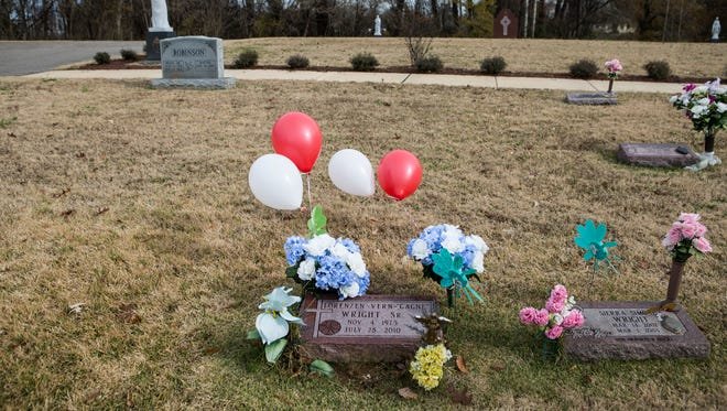 Flowers and balloons adorn the grave of Lorenzen Wright on Dec. 6, 2017, in the Calvary Cemetery & Mausoleum. Billy R. Turner, 46, has been arrested and charged with murder in the killing of Wright, the basketball standout whose body was found in 2010 and whose slaying has remained a mystery for years, officials announced Tuesday.