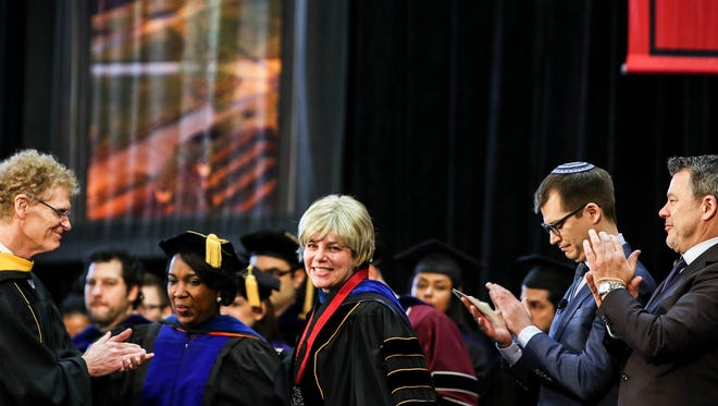 January 13, 2018 - Dr. Marjorie Hass, center, smiles while receiving a standing ovation after being inaugurated as the twentieth president of Rhodes College. Hass is the college's first female president.