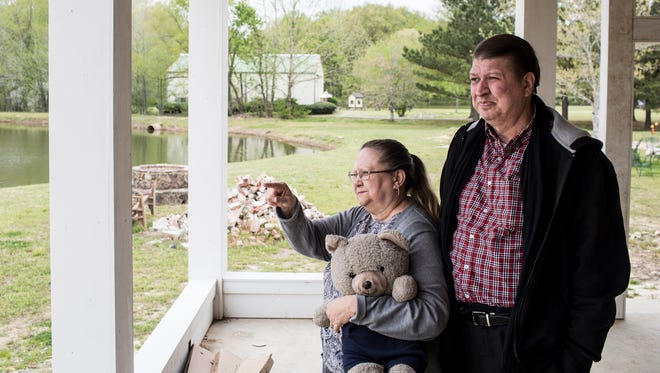 "April 19, 2018 - Gayle Ennis points out to a large pond on the property that she and her husband, Joe, bought more than a decade ago.  Parts of the property are being transformed into Joe's dream of building Mark's Park, a special ""humorous"" nature park built exclusively for children and adults with autism."