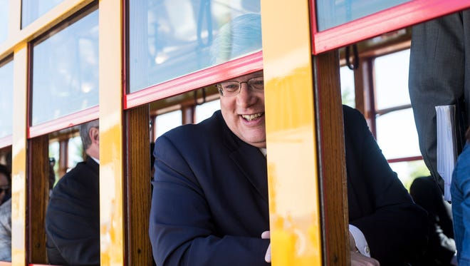 April 30, 2018 - Memphis Mayor Jim Strickland smiles after finding a seat on the first trolley to run with passengers in nearly four years during the grand re-opening ceremony for the Main Street Trolley.