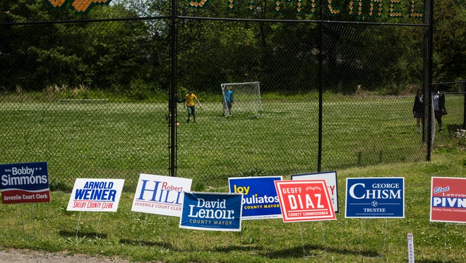 May 01, 2018 - Campaign signs line the entrance to the polling location at St. Michael School on Election Day on Tuesday.