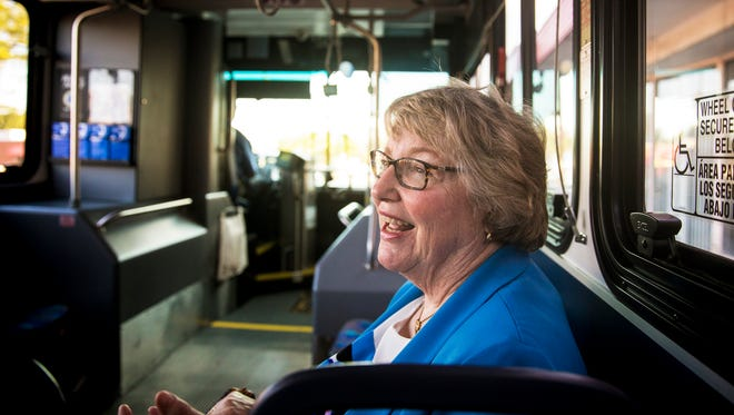 Pat Heasley rides the 30X bus to downtown Cincinnati from Mount Washington Wednesday, June 6, 2018. Heasley has been been riding the bus for three years. She has read 82 books on her morning and evening 20-minute commute.