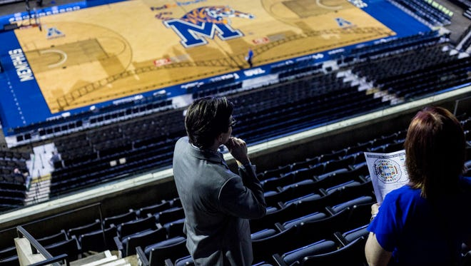 Lexanne Horton, right, and her son, Jerry Richards, look for seats at FedExForum in June during a public seat selection for season-ticket holders.