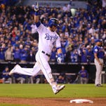 Kansas City Royals left fielder Alex Gordon celebrates after hitting a solo home run against the New York Mets in the 9th inning in game one of the 2015 World Series at Kauffman Stadium.