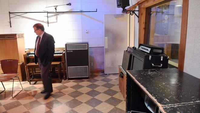 John Patterson, senior vice president of Mercer University, walks around RCA Studio B in Nashville.