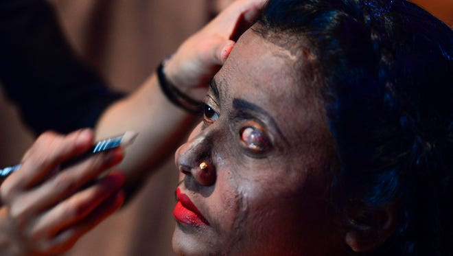 """A Bangladeshi acid attack survivor has her makeup done backstage prior to the fashion show """"Beauty Redefined"""" by designer Bibi Russell, featuring acid attack survivors in Dhaka on March 7, 2017.  Survivors of acid attacks blazed through a unique fashion show in the Bangladeshi capital Dhaka March 7 in an effort to smash the conservative country's social prejudices about the victims."""