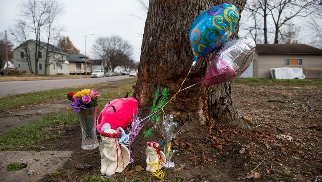 Flowers, balloons and other objects sit at the corner of Linwood and Monroe avenues in Evansville, Ind., on Thursday, Nov. 30, 2017. Prince Carter, 7 months, and Princess Carter, 2, both died as a result of the crash following a police chase Wednesday night, according to Vanderburgh County Coroner Steve Lockyear.