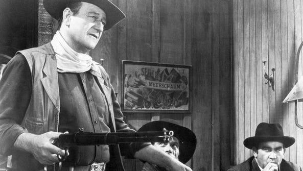 John Wayne and Ed Asner, right, in 'El Dorado'.