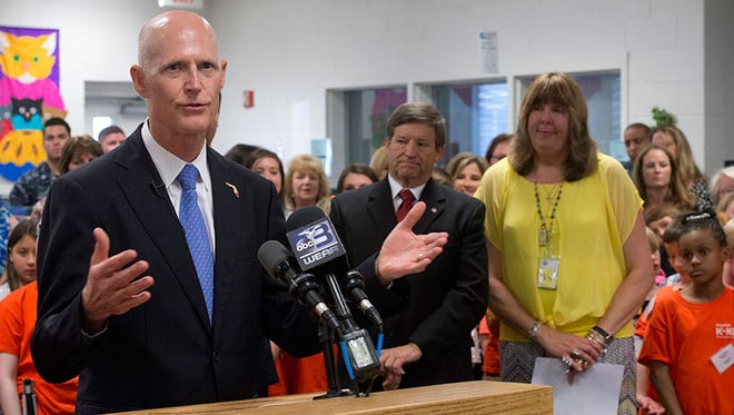 Gov. Rick Scott visited Blue Angels Elementary School Monday afternoon to present the Escambia County School District with a check for $1.42 million in funding for 22 Pensacola schools.