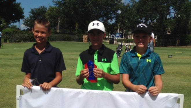 Sam Kodak of Naples (center) won the Boys 12-13 Division at the Drive, Chip and Putt Championship local qualifier on Thursday, June 30, 2016, at Stoneybrook Golf Club in Estero. Logan Eakins of Fort Myers (left) and Noah Kent of Estero also advanced to the subregional on Aug. 13. (Greg Hardwig/Staff)