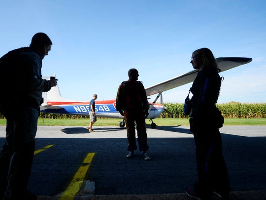 Skydivers prepare to board a plane for the first jump of the day.