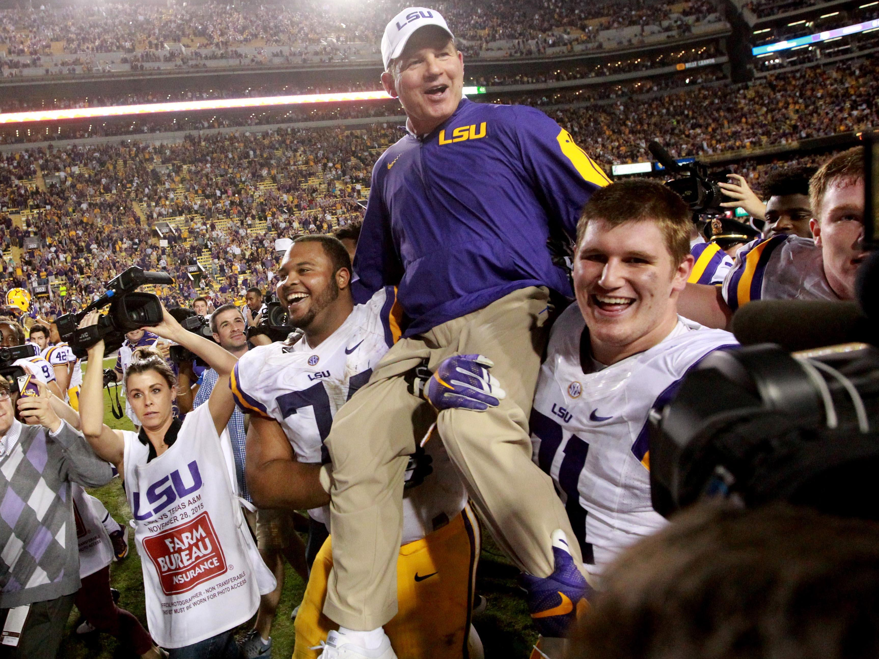 LSU head coach Les Miles is carried by his players after defeating the Texas A&M Aggies 19-7 at Tiger Stadium.