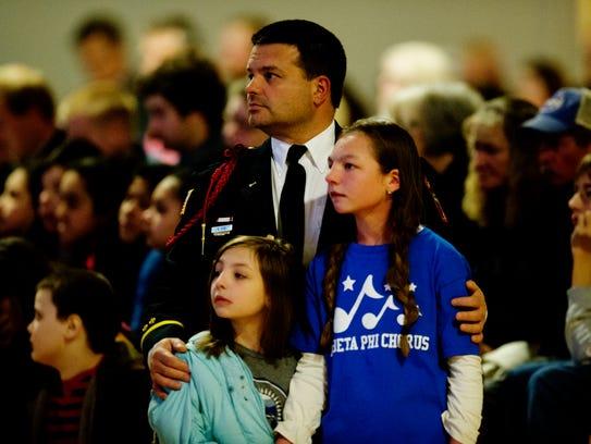 Gatlinburg firefighter Steve Ebb holds his daughters