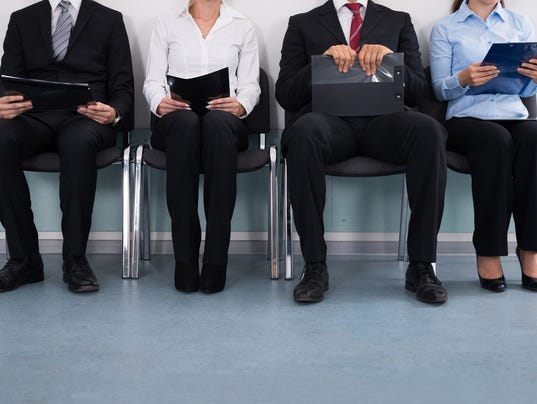 Businesspeople Sitting On Chair