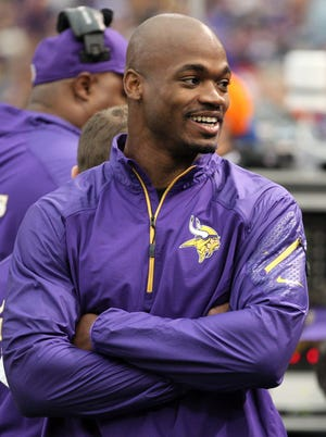 Minnesota Vikings running back Adrian Peterson (28) smiles on the sidelines during the first quarter against the Philadelphia Eagles at Mall of America Field at H.H.H. Metrodome.