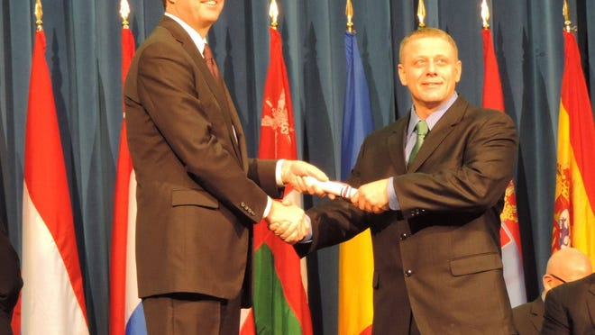 Webster Police Lt. Joseph Rieger, right, graduated recently from the FBI National Academy. With him is FBI Director James Comey Jr. Rieger will be named Webster's interim chief.