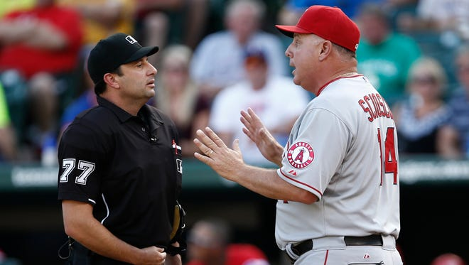 Mike Scioscia, one of several managers who are former catchers, would like to see Rule 7.13 revised before the playoffs.