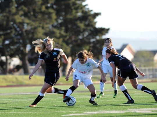 The Wind's Belinda Ascencio fights off Sting Ray defenders during the 2017 Salinas Californian All-Star Classic soccer matches on Sunday, March 12th.