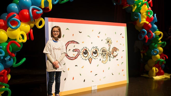 Bria Neff stands next to her GoogleDoodle during a ceremony at the Washington Pavilion.