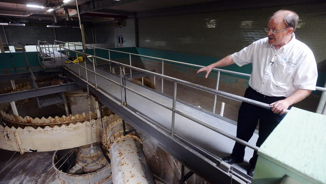 Tim Stefanich, environmental engineer at the Sioux Falls water purification plant on Monday shows an empty softening basin where incoming water is mixed with lime, which helps any solids fall out of suspension.