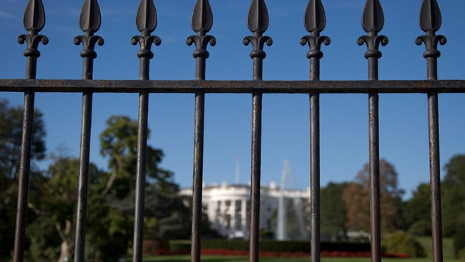 In this Sept. 22, 2014 file photo, the iron perimeter fence lines the South Lawn of the White House in Washington.