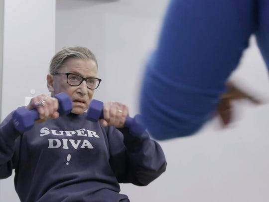 """Supreme Court Justice Ruth Bader Ginsburg is captured doing her workout routine in """"RBG."""" The documentary opens Friday at Small Star Art House."""