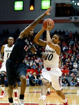Cincinnati Bearcats guard Troy Caupain (10) drives to the basket against San Diego State Aztecs forward Winston Shepard (13) during the first half at Fifth Third Arena.