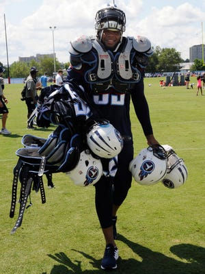 Titans rookie outside linebacker Kevin Dodd carries teammates' gear on Aug. 1, 2016.