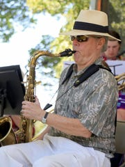 David Bolsover plays the saxophone June 25 with the Cedar Jazz Dectet at a memorial concert for Tim Cretsinger at Main Street Park in Cedar City.