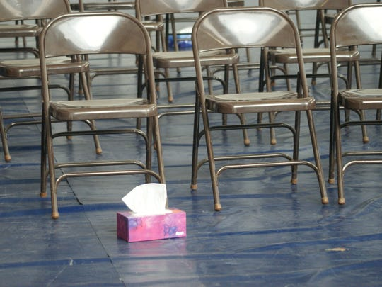 A single box of tissue left behind after the memorial service for Meghan Flores at Deming High School's gymnasium.